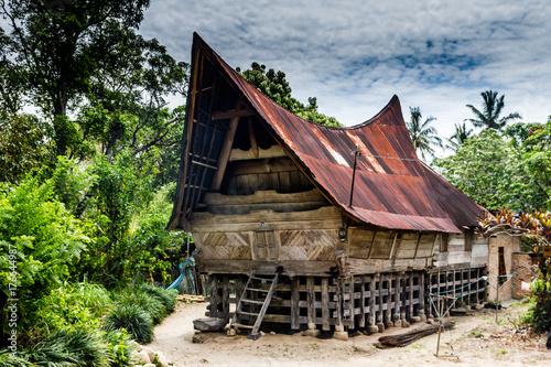 Traditional Batak longhouse on the shores of Lake Toba, Sumatra Canvas Print