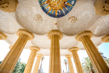 Vew From Below On The Beautiful Columns Of The Main Terrace In Guell Park In Barcelona