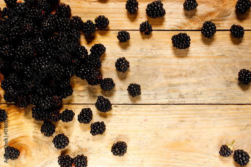 Fotografia, Obraz  Ripe blackberries in a basket on a rustic wooden table.