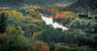Picturesque view on valley of Gaujas national park. Trees changing colors in foothills. Colorful Autumn day at city Sigulda in Latvia.