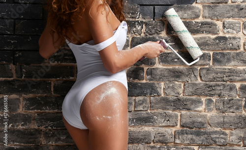Fotografie, Obraz  young female construction worker butt glamour sexy young woman wearing white bod