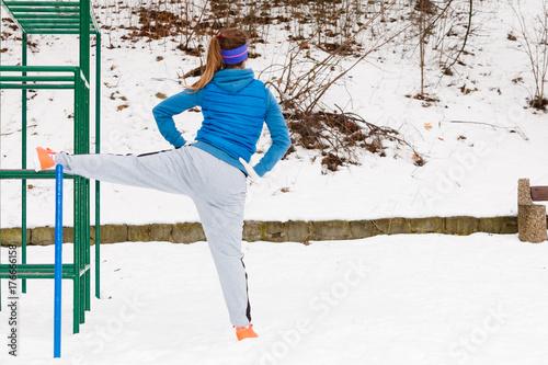 Foto op Aluminium Dance School Woman wearing sportswear urban exercising outside during winter