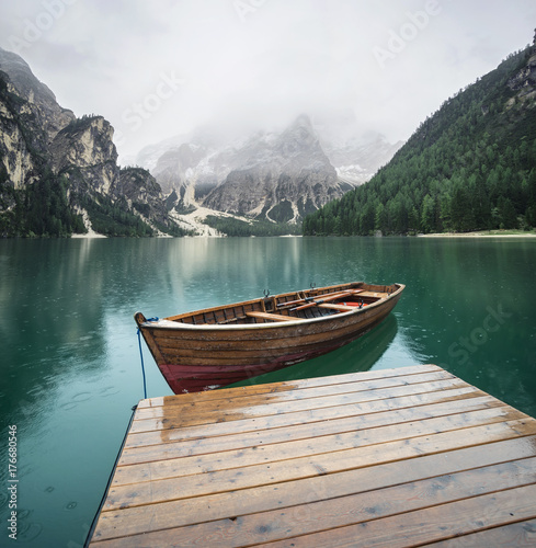 Photo Stands Lake Lake in the mountain valley in the Italy. Beautiful natural landscape in the Italy mountains.