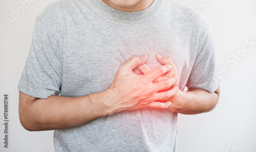 Fotografia  a man touching his heart, with red highlight of heart attack, and others heart d