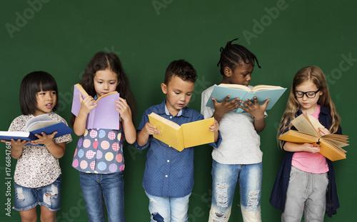 Fotografie, Obraz  Group of school kids reading for education