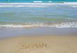 Spain written in sand beach