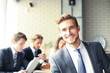canvas print picture - Businessman with colleagues in the background in office.