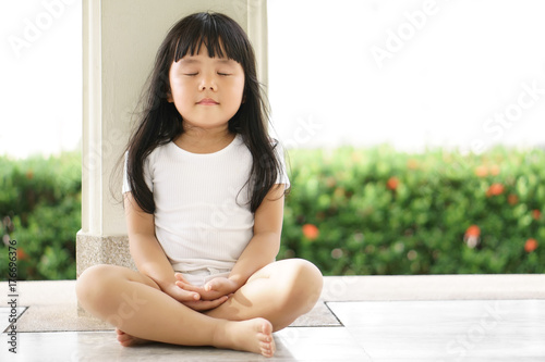 Stampa su Tela Asian children cute or kid girl sit for meditation with peace and relax in garde