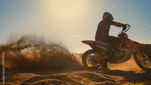 Professional Motocross FMX Motorcycle Rider Drives in Circles on the Off-Road Deserted Quarry.