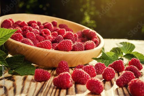 Fototapeta raspberries in a plate,in wooden bowl,basket/bush branch/growing raspberries,raspberries background closeup photo,high resolution product,Delicious first class organic fruit,Raspberry as background obraz na płótnie