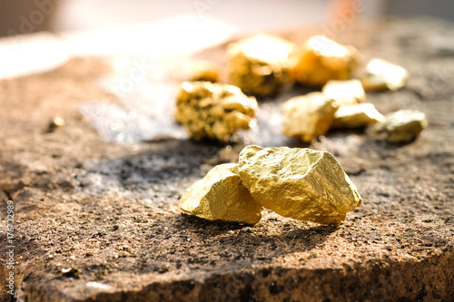 Fotografia, Obraz  The pure gold ore found in the mine on a stone floor
