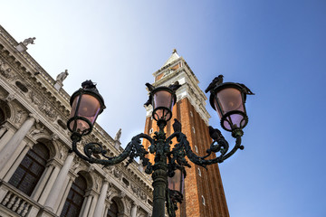Fototapeta na wymiar Lanterns with pigeons on Saint Mark's Square (Piazza San Marco) in Venice, Italy