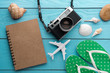Summer holiday background, Travel and vacation items on wooden table. Top view
