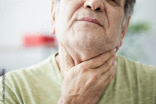Cuadros en Lienzo Old man feeling painful in the throat