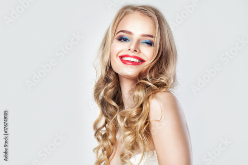Happy Smiling Woman Fashion Model Pretty Female Face With Blonde Curly Hair Makeup And Cute Smile On Banner Background With Copy Space Buy This Stock Photo And Explore Similar Images At