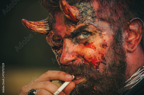 Photo  Halloween devil smoking cigarette