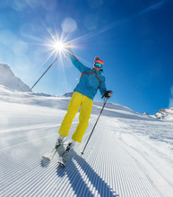 Happy Young Man Skier Enjoying Sunny Weather In Alps