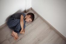 Little Boy Lying On Floor In C...