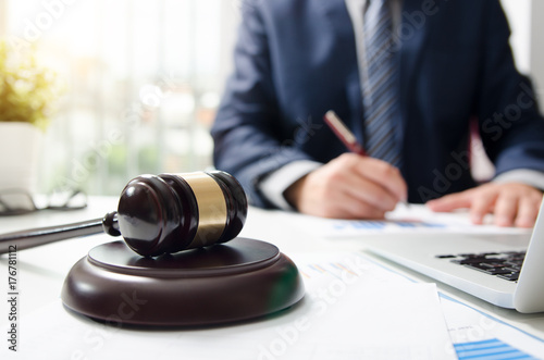 Wooden gavel on table. Attorney working in courtroom. Wallpaper Mural