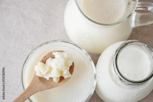 Fotografie, Tablou  Organic probiotic milk kefir grains, Tibetan mushrooms on wooden spoon and kefir