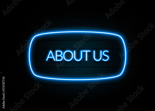 Photo  About Us  - colorful Neon Sign on brickwall