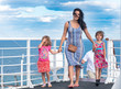 Mother and two girls on cruise ship on windy deck
