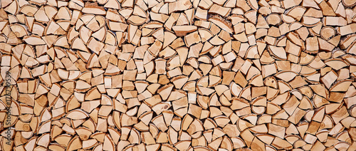 Photo Stands Firewood texture Wooden background of shattered tree trunks