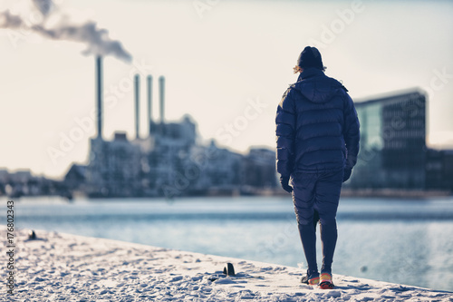 Fotomural Winter city smog pollution people walking in warm outerwear in cold morning commute