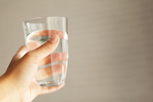 Woman Holding A Glass Of Water...