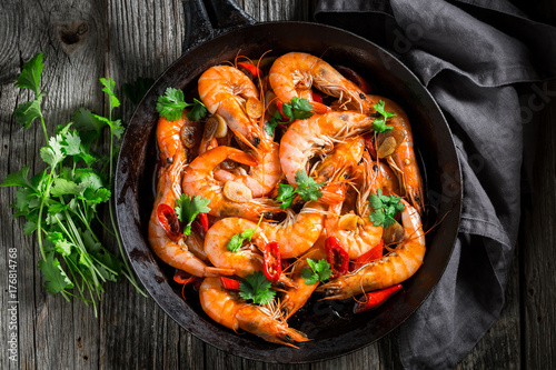 Spicy shrimps on pan with parsley and garlic