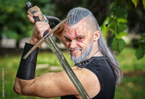 Photo  Cosplay character, dressed like a Geralt of Rivia from the game The Witcher