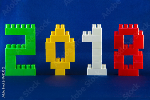 Tambov, Russian Federation - September 28, 2017 Lego New year 2018 concept with Lego cubes on blue background Poster