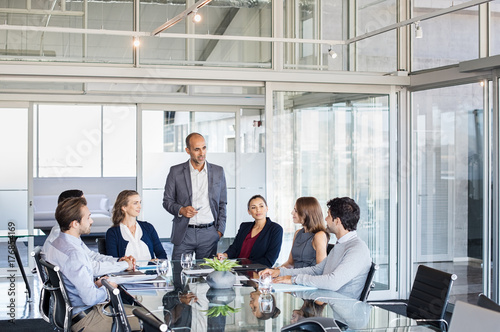 Obraz Business people having meeting in conference room - fototapety do salonu