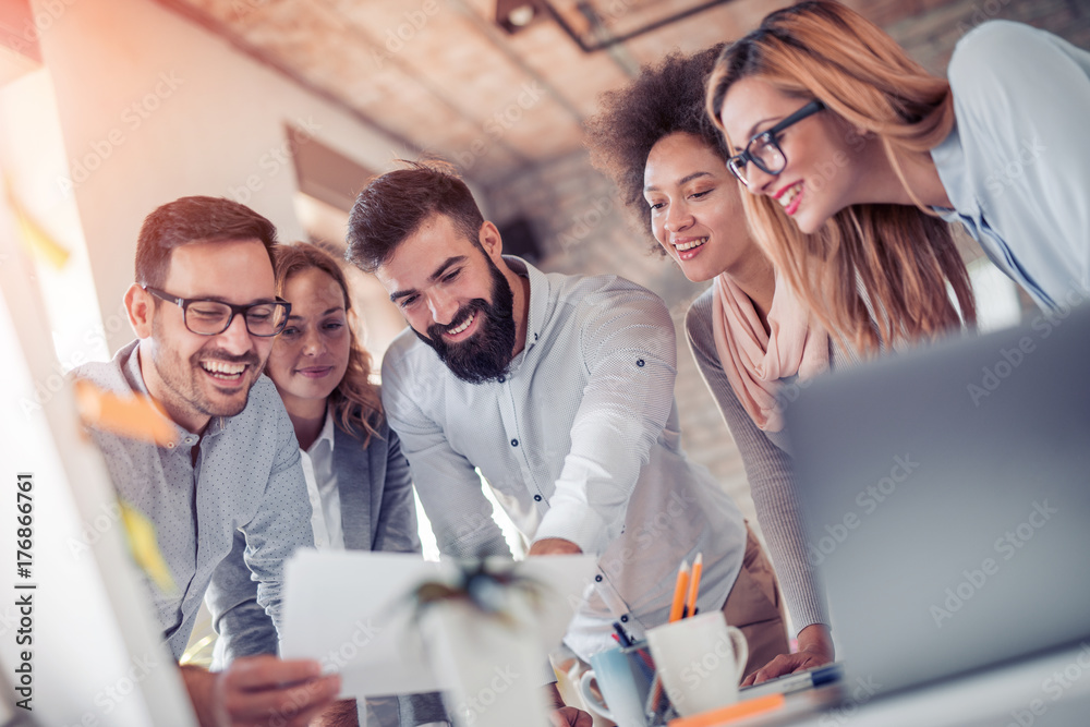Fototapeta Young business people in modern office