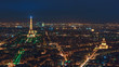 Niight aerilal view to Eiffel tower and les Invalides area in Paris. Copy space in sky.