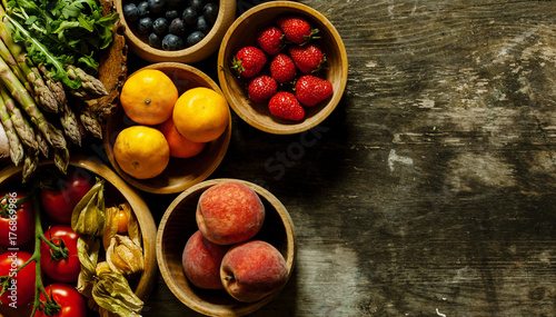 Fruit and vegetables on wooden table.