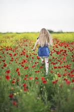 Happy Girl Running In Poppy Fi...