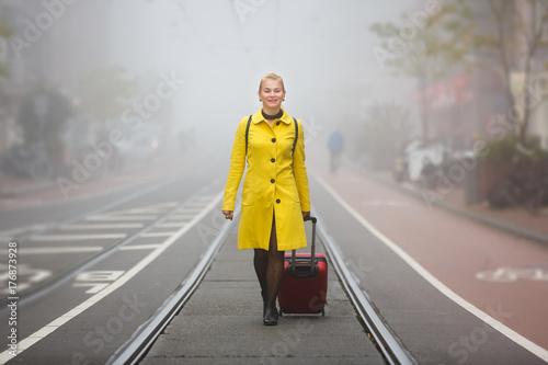 Traveler in misty Amsterdam Canvas Print