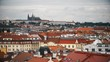 Summer aerial timelapse view of the Old Town architecture with red roofs in Prague , Czech Republic. St. Vitus Cathedral in Prague. Time lapse. Hyperlapse.