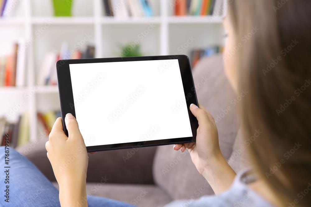 Fototapeta Woman watching media showing a tablet screen