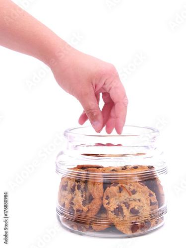 Hand in cookie jar Fototapeta