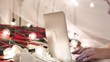 young woman lies on a bed with a laptop on a garland background, video chat, make an online purchase