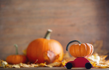Maple Leaves And Pumpkins With...