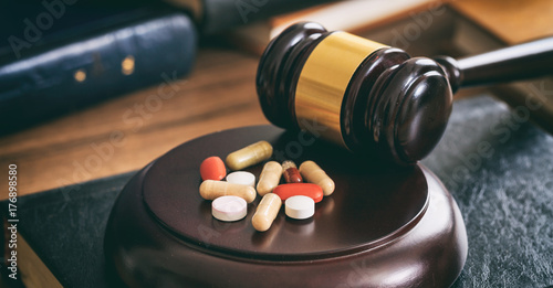 Fotografija Judge gavel and drugs on a wooden desk