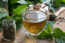 A Cup Of Nettle Tea With Fresh...
