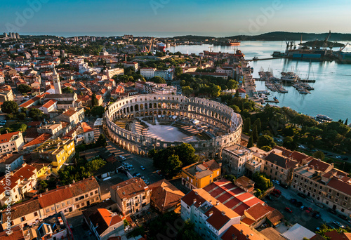 Photo  Pula Arena at sunset - HDR aerial view taken by a professional drone