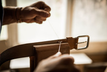 Man Sewing Leather Belt