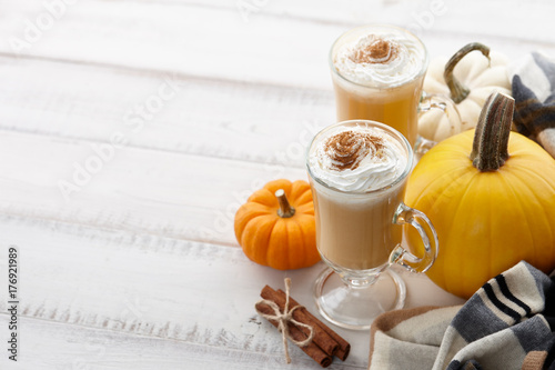 Fall pumpkin spice latte with whipped cream and cinnamon, ornamental pumpkins an Wallpaper Mural