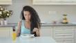 Woman eats breakfast at the kitchen