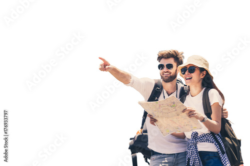 Foto Multi ethnic couple look at map while pointing finger in the direction of destination